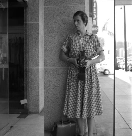 Vivian Maier: Self-Portrait (Full-Length, Checkered Dress), 1955